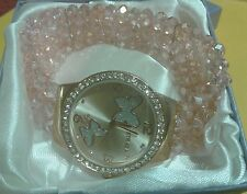 """PINK TRIPLE STRAND CRYSTAL LARGE FACE WATCH W/BUTTERFLY IN FACE-7 1/2"""" TO 10"""""""