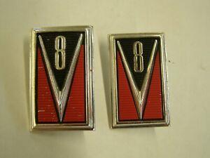 NOS OEM Ford 1965 Mercury Comet V8 Fender Emblems Ornaments Trim Pair