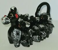 VINTAGE BLACK POODLE CLAY/ porcelain SALT & PEPPER SHAKERS IN POODLE HOLDER