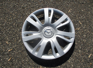 One factory 2011 to 2014 Mazda 2 15 inch hubcap wheel cover