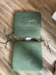 Two Green Outdoor Water Resisant Seat Cushions