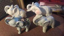 Lot of 4 Small Sleek White Ceramic Elephant Figurines