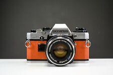 Olympus OM10 35mm Film Camera w/50mm f/1.8 Zuiko Lens Orange Leather   Serviced