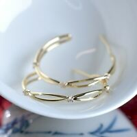 18k yellow gold hoop stud earrings made with SWAROVSKI crystal open hoops 27mm