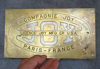 plaque publicitaire compagnie JOY - paris france usa en laiton