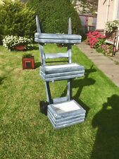 3 Tier Wooden and FIBREGLASS flower stand. Long lasting strong material