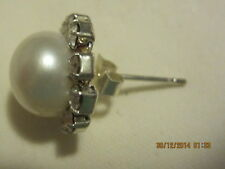 Earrings -  Shell Pearl surrounded by Crystals. Studs on Silver Plated backings