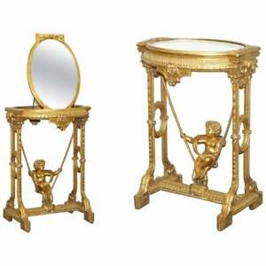 CIRCA 1920 GOLD GILTWOOD OCCASIONAL TABLE WITH MIRROR TOP & CHERUB PUTTI SWING