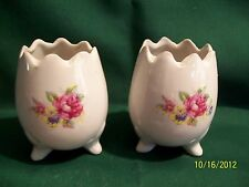 Two charming, small footed cracked egg cups, hand painted or with a transfer pat