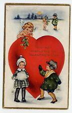 POSTCARD VALENTINE VINTAGE WHITNEY - GIRL AND BOY IN WINTER - CUPID - MISTLETOE