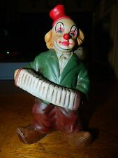 clown figurine playing the accordion
