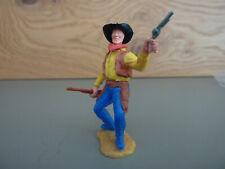 Timpo / Cowboy stehend mit Colt + Gewehr / UT dunkelblau, Weste braun Hemd gelb