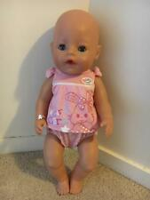 Used Baby Born doll with accessories