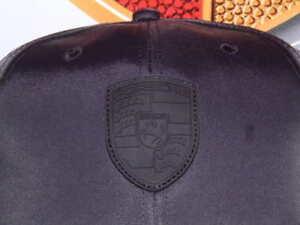 PORSCHE DESIGN DRIVER'S SELECTION CRESTED BLACK ON BLACK HAT WITH RED TRIM. NIB.