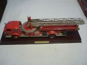 A Franklin mint of a scale model of a 1954 American La France Fire engine, base