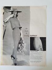 1958 women's she must be wearing Gossard answer girdle fashion ad