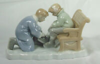 Russ Father Helping Son Tie Ice Skate Figurine