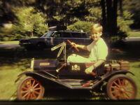 vintage 35mm slide Boy in vintage toy car