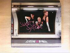 CD / SWEET SYSTEM / LIVING IN PARIS / NEUF SOUS CELLO