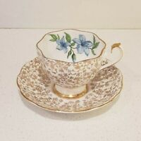 Gold lace tea cup and saucer with a blue flower and gold edge, Made in England