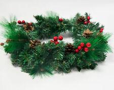 Ghirlande, corone e fiori natalizi verde
