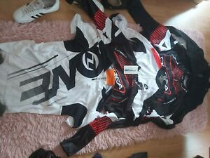 various cycling attire 7 long sleeved tops, 4 short sleeved tops 3 bottoms