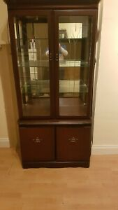 Mahogany unit, excellent condition lights on the inside of glass