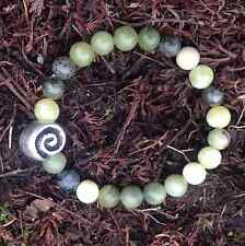 Connemara marble stretch bracelet Celtic spiral bead. Men women Irish jewelry