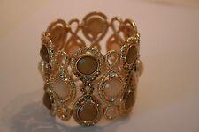 International Concepts Gold tone cream & olive green rhinestone stretch bracelet