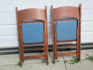 2 vintage Wood Folding Chairs with Blue Vinyl Seats that are in good shape