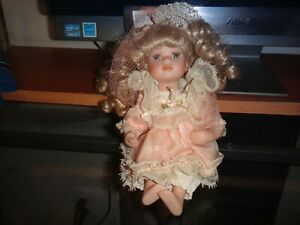 COLLECTION ETC. CO. PORCELAIN DOLL W/PINK DRESS & BLOND CURLEY HAIR W/HAT