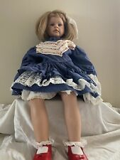 "really cute porcelain doll marked  ms1026 22"" sitting  bent knees"