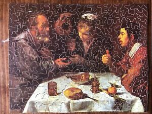 VINTAGE WOODEN JIGSAW PUZZLE OF  AN OLD MASTER PAINTING OF FIGURES AT A TABLE-