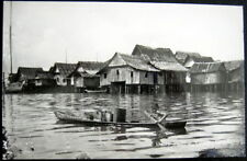 SINGAPORE~1940's MALAY FISHING VILLAGE~BOY IN CANOE ~ Real Photo PC  RPPC