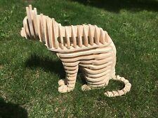 Figurine of a cat made of birch will