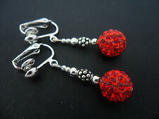 A PAIR OF DANGLY RED SHAMBALLA STYLE  CLIP ON   EARRINGS.