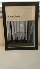 Stranger Things A3 book cover style Poster in a brand new black wooden frame