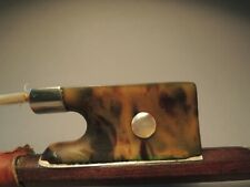 Fine old violin bow. Shell frog