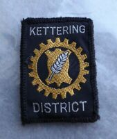 Vintage Scouts cloth badge, Kettering District, 2 x 1.5 inches, good condition.
