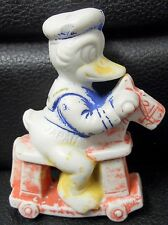 Donald Duck Bisque Riding on Hobby Horse, Japan, Antique