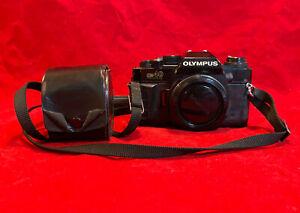 Vintage Olympus OM40 35mm SLR camera with 50mm 1.8 lens, c. 1985