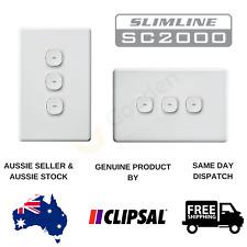 New - Clipsal Slimline Impress Push Button 3 Gang Light Switch (Blue LED)