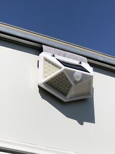 100 LED White Caravan Solar PIR Motion Sensor Light - slides on awning rail.