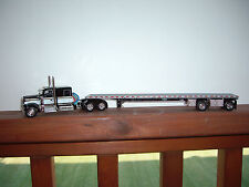 DCP 1/64 BLACK&WHITE W900 KENWORTH WITH 60'' SLEEPER AND SPREAD AXLE FLAT BED