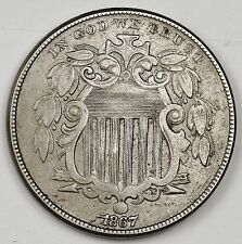 "1867 Shield Nickel.  Die Break thru ""1867"".  X.F.  99551"