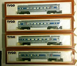 Four Ho Scale Tyco Amtrak car