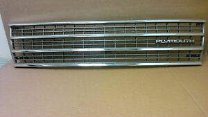 91' - 95' Plymouth Voyager chrome and silver grille with emblem  OEM