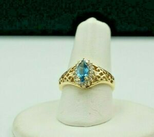14K Yellow Gold .63ct Marquise Blue Topaz & 16 Diamonds .16ct total Appraisal