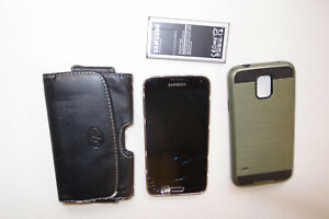 Unlocked Samsung Galaxy S5; T-Mobile SM-G900T3 16GB; Works great cracked screen!