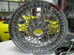 DUNLOP WIRE WHEEL SET OF 4 NEW IN BOX  FOR  HEALEY,  MGA, LOTUS, TRIUMPH TR3 TR4